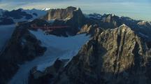 Alaska Rugged Mountain Aerials With Bush Plane Tracking Shot Toursim Ecotourism Alaska Economy