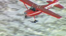 Alaska bush plane flying over glaciers and rugged mountains, alaska transportation remote