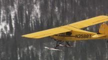 Alaska Bush Plane Yellow Supercub Cub On Skiis Flying In Winter