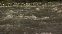 Close Up Tilt Up Rushing River Water Hulahula River In Arctic National Wildlife Refuge