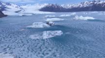 Aerial Over Blue Frozen Glacier Lake