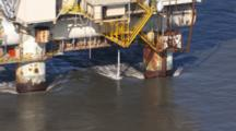 Oil Derrick In Cook Inlet Alaska With Discharge From Pipe