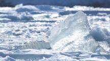 Icebergs Rush By Bobbing In Ocean Swells