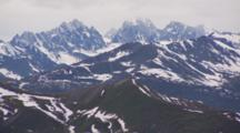Cineflex Aerial Flight Over Rugged Snow Covered High Mountain Crags