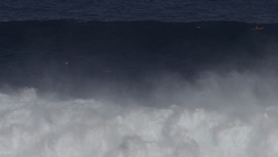 Jaws - big wave surfing- big wave breaking-surfers paddling
