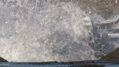 Big waves are hammering a rocky coastline