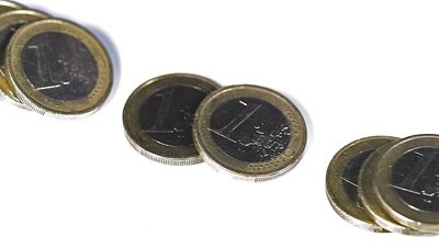 Coins of 1 Euros Falling against White Background, Slow motion
