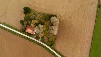 Flying over a country house in the fields