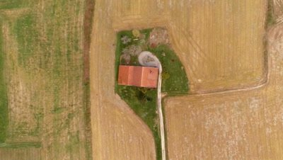 Flying over a country farmhouse