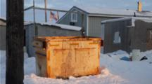 Houses And Dumpster And Us Flag In Barrow, Alaska In The North Slope, Village / Town In Winter, Snow, Houses, Subarctic, Arctic Living, Midnight Sun