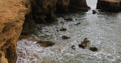 4K UltraHD Waves burst over rocks in the Algarve, Portugal
