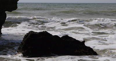 4K UltraHD Waves burst over rocks in the Algarve in Portugal