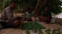 People Sell Betel Palm Nuts At Local Beach Market, Milne Bay, Papua New Guinea