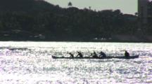 Waikiki Canoeing Sillhouetted On A Shimmering Sea
