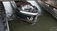 A Cargo Ship Steaming Under A Bridge And Towards The Camera, High Angle