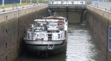 A Cargo Ship In A Dutch Lock, Doors Closing As Shot Zooms Out, High Angle