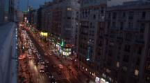 A Hi Angle Shot Of A Busy Street In Madrid Spain At Night, Dutch Angle