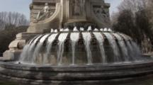 A Water Fountain In The Plaza De Aspana In Madrid, Spain.