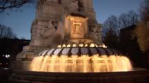 A Water Fountain In Plaza De Aspana In Madrid, Spain, At Dusk.