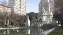 A Statue Of Don Quixote In Front Of A Reflecting Pool In Plaza De Aspana In Madrid, Spain.  Tourist Attraction.
