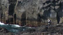 Miyake Jima, Japan - Fisherman On Lava Coastline, Wide Shot