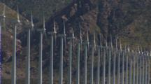 Wind Turbine Front Lit At Base Of Mountains, Side View