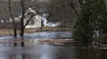 Major Flooding In A Small New England Town, River Has Overflowed It's Banks And Rages Through Yards