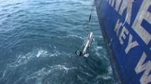 Side Scan Sonar Fish Being Recovered From The Water Off Stern Of Ship