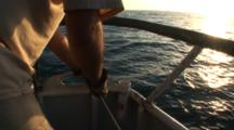 Side Scan Sonar Armored Cable Being Locked In Place, Crew In Sunset