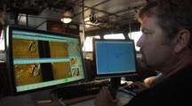 Side Scan Sonar Operator Observes Computer Displays