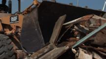 Front Loader Moves Remnants Of Old Boat