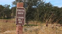 Close Up Of Sensitive Habitat Sign With Oak Woodland In The Background, Speces:  Blue Oak (Quecus Douglasii)