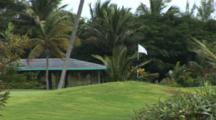 Golf Course In The Tropics With White Flag Flying In Breeze