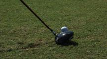 Close Up Of Ball Being Hit By Golf Club