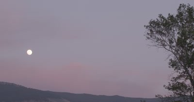 4K Full moon rising time lapse over sunset hills - No Colour Correction