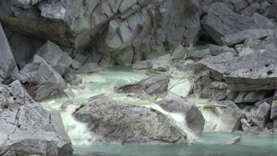 4K Mineral stream, sulfur spring, from rock face empties in to fresh water creek, Tight Shot - NOT Colour Corrected