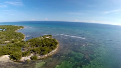low aerial of Jardines de la Reina reef,beach,mangroves and lagoon