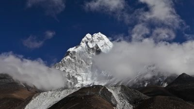 Time-lapse of clouds passing in front of a Himalayan peak.