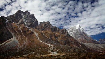 Time-lapse of rocky Himalayan peaks and passing clouds.