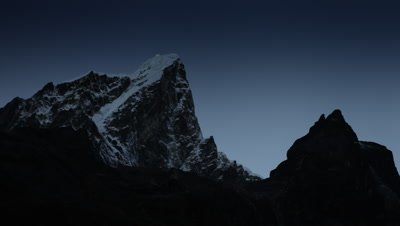 Time-lapse of the moon passing by Himalayan peaks at sunrise.