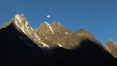 Time-lapse of the moon going behind Himalayan peaks in the morning.