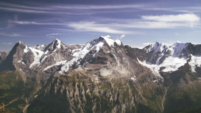 Static shot of foggy Swiss Alps.