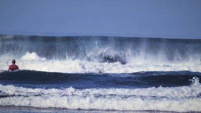 Shot of a man playing in the ocean at the Costa Rican coastline