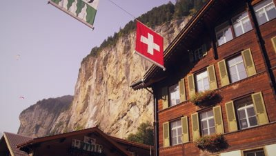 Panning shot of paragliders from Lauterbrunnen, Switzerland