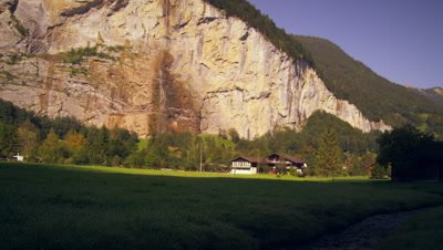 Small brook, houses, waterfall of Lauterbrunnen Valley