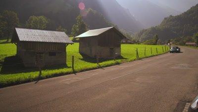 Convertible drives through small Swiss village