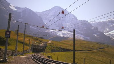 Swiss railway in front of Alps in Grindelwald, Switzerland