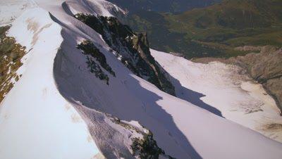 Tilting shot on the peak of the Swiss alps