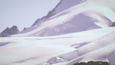 Tilting shot of snow-covered mountain peak in Switzerland
