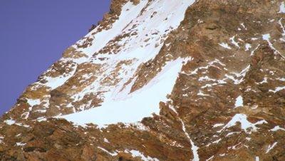 Tilting shot of Swiss alp peak